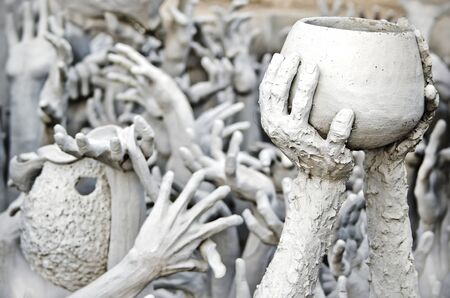 Hands statue from hell in Wat Rong Khun, Chiang Rai province, northern Thailand  photo