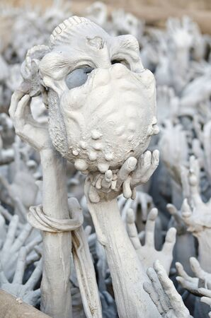 Skull and Hands from hell in Wat Rong Khun, Chiang Rai province, northern Thailand  photo
