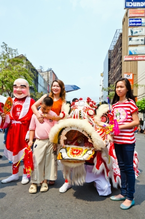 BANGKOK, THAILAND - FEBRUARY 10: Unidentified people celebrate with chinese lion at Yaowarat Road in Chinatown district during the Chinese New Year celebrations on February 10, 2013 in Bangkok, Thailand