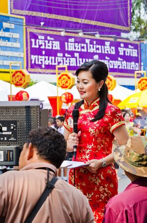 BANGKOK, THAILAND - FEBRUARY 10: Unidentified  reporter  making report for television in Chinatown district during the Chinese New Year celebration on February 10, 2013 in Bangkok, Thailand Editorial
