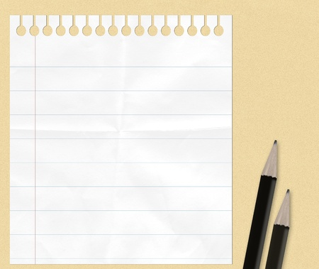 notebook paper  with pencils  for your text photo