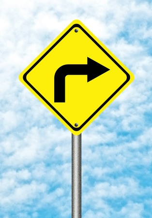 Turn right yellow traffic sign  on blue sky photo