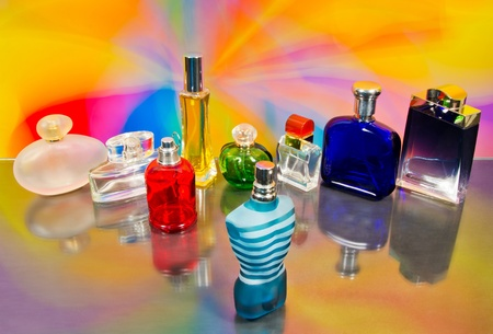 set of luxury perfume bottles  on colorful background photo
