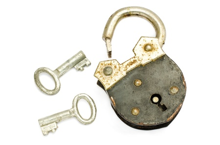 Old padlock and key on white background