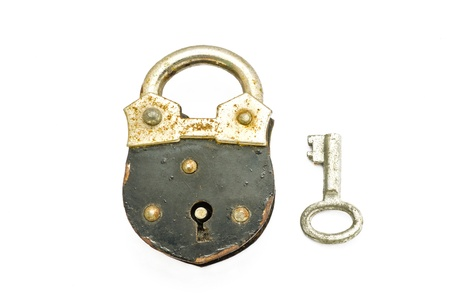 Old padlock and key on white background photo