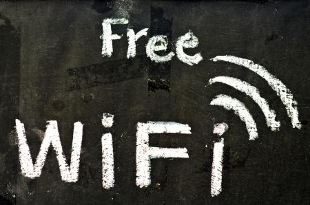 Free wifi symbol written on blackboard