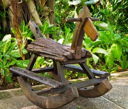 Old wooden rocking horse  in the park Stock Photo - 20196999