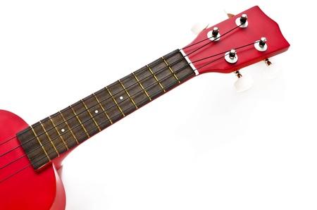 Part of red ukulele isolated on white background.
