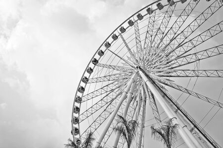 Big ferris wheel against  blue sky Processed with black and white style