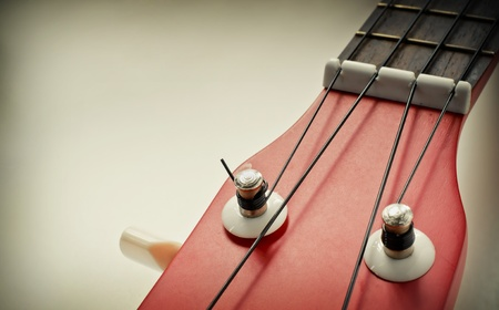 Part of red ukulele with text area Processed with vintage style  Soft focus Stock Photo - 20435583