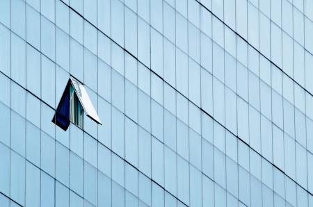 One open window in modern glass wall office building Reklamní fotografie