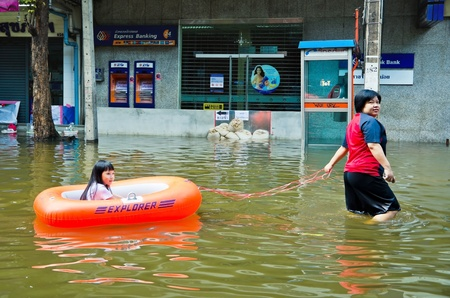 worst: BANGKOK, THAILAND - OCT 29: Unidentified people use boat as a transportation during the worst flooding on October 29, 2011 in Bangkok, Thailand Editorial