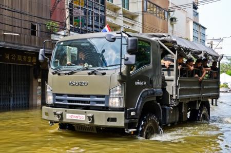 krung: BANGKOK, THAILAND - OCT 31: Royal Thai Army navigates through the flood at Charoen Krung road during the worst flooding on October 31, 2011 in Bangkok, Thailand