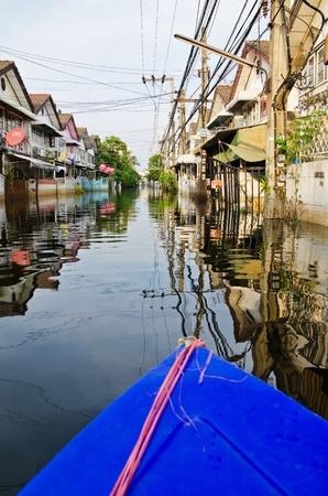 BANGKOK, THAILAND - NOV 5: The worst flood on village at Jaransanitwong road    during Thai flood crisis on November 5, 2011 in Bangkok, Thailand