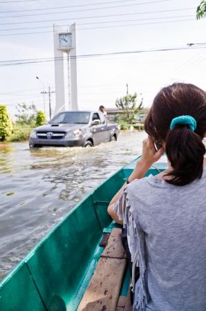 NAKHON PATHOM, THAILAND - NOV 15: Scene from  Phutthamonthon Sai 4 road  during the worst flooding crisis  on November  15, 2011 in Nakhon Pathom, Thailand