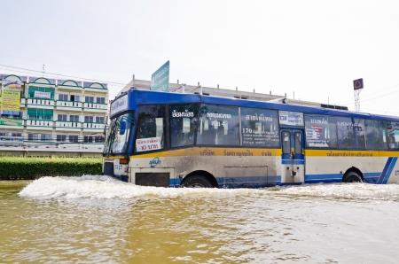 NAKHON PATHOM, THAILAND - NOV 15:  Large bus carried flood victims  at   Phutthamonthon Sai 4 road  during the worst flooding crisis  on November  15, 2011 in Nakhon Pathom, Thailand Editorial