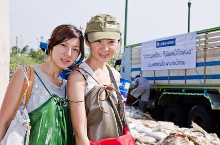 worst: NAKHON PATHOM, THAILAND - NOV 15:  Unidentified women wear wader cloth  at  Utthayan road  during the worst flooding crisis  on November  15, 2011 in Nakhon Pathom, Thailand Editorial