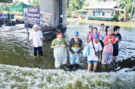 worst: NAKHON PATHOM, THAILAND - NOV 26: Scene from  Phutthamonthon Sai 4 road  during the worst flooding crisis  on November  26, 2011 in Nakhon Pathom, Thailand
