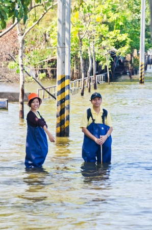 NAKHON PATHOM, THAILAND - NOV 26: Scene from  Phutthamonthon Sai 4 road  during the worst flooding crisis  on November  26, 2011 in Nakhon Pathom, Thailand