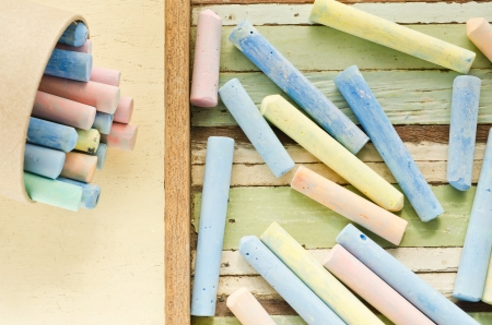 Close-up of colorful chalks on wooden table photo