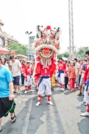BANGKOK, THAILAND - FEBRUARY 10  Unidentified people celebrate with chinese lion at Yaowarat Road in Chinatown district during the Chinese New Year celebrations on February 10, 2013 in Bangkok, Thailand