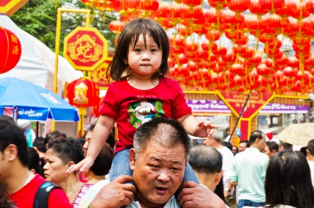 5 10 years old: BANGKOK, THAILAND - FEBRUARY 10  Unidentified child, age about 5 years old, celebrates Chinese New Year on February 10, 2013 on Yaowarat Road in the Chinatown district of Bangkok, Thailand  Editorial