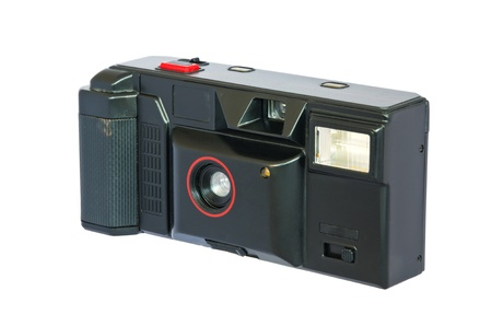 Old compact vintage camera against white background  Clipping path included to replace background  photo