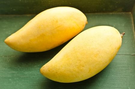 Fresh golden mango on wood table Stock Photo