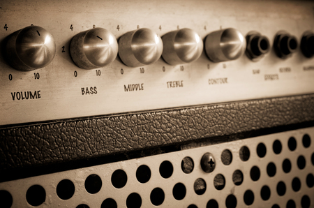 Close-up of guitar amplifier.Processed with vintage style. photo