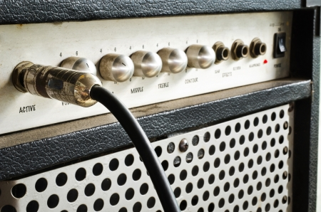 guitar tuner: Close-up of guitar amplifier with jack cable