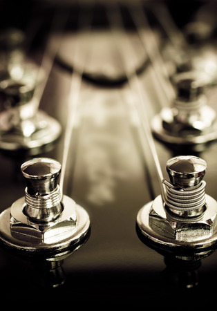 frets: Close up of electric guitar headstock,soft focus, vintage  color tone.
