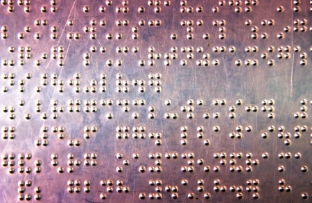 Metal sheet with braille dots background Standard-Bild
