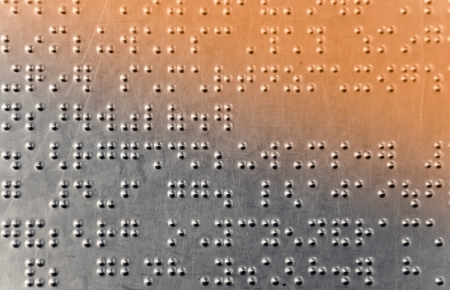 Metal sheet with braille dots background photo