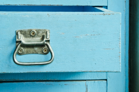 Vintage wooden blue cabinet with open drawer Stock Photo