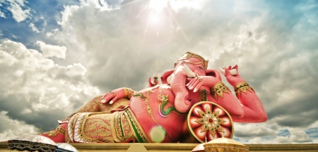 Big pink Ganesha statue in relaxing action, Thailand  photo