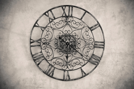 Clock with roman numbers  on the wall  Processed with vintage style