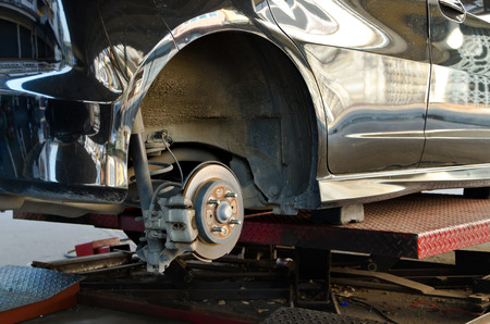 Modern Car take wheel off show disk brake assembly photo