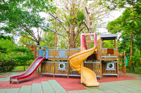 playhouse: Children playground equipment in the form of pirate ship at the park  Stock Photo