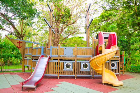 Children playground equipment in the form of pirate ship at the park  Stock Photo