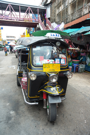 tuktuk: CHIANGMAI, THAILAND - JULY 29:  Famous three-wheeled taxi (tuktuk) parking at the street on July 29, 2014  in Chiang Mai,Thailand. Tuk Tuk  is one of the public transport in Thailand. Editorial