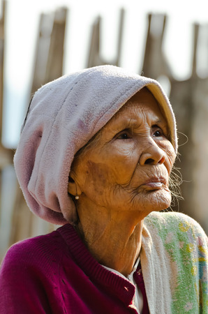 KANCHANABURI THAILAND-January 29: An unidentified old Mon ethnic woman poses for for camera at her house on January 29, 2012  at KANCHANABURI THAILAND. Mon are an ethnic group spread in Thailand. Editorial
