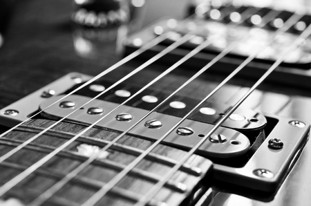 Detail of six-string electric guitar closeup, selective focus.Processed with vintage style. photo