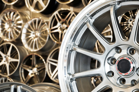 Various alloy wheels in store, selective focus.