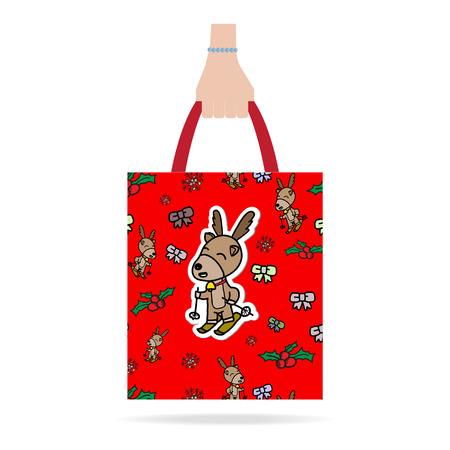 shoping bag: Hand with Christmas shopping bag.