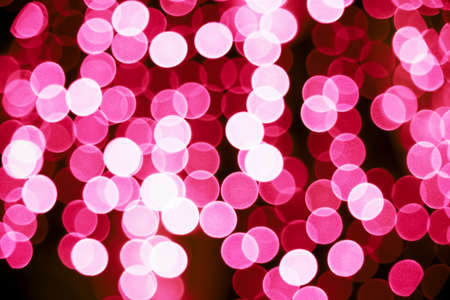 Red circular bokeh background against dark background for use at graphic design Stock Photo