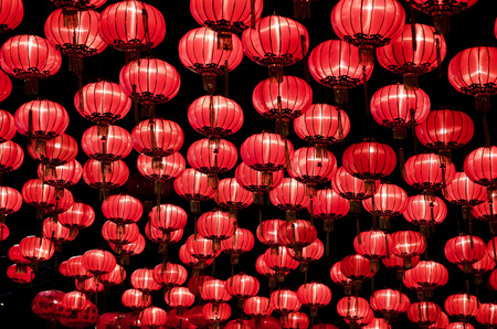 chinese new year decoration: Chinese red lanterns hanging  in street at night during the Chinese New Year Stock Photo