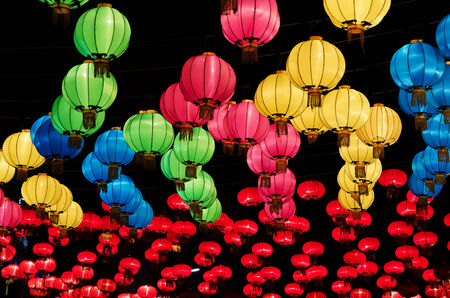 Chinese lanterns hanging  in street at night during the Chinese New Year photo