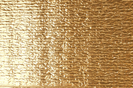 Gold aluminum foil texture closeup , can be used for background Stock Photo