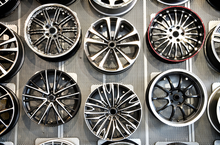 Various alloy wheels in store. Stock Photo