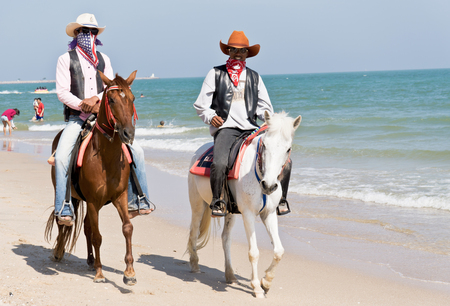 PHETCHABURI , THAILAND - JANUARY 3: An unidentified people riding on horse back at Cha - am beach  on January 3, 2015 in Petchaburi, Thailand. Cha - am beach is the famous seaside resort in Thailand.